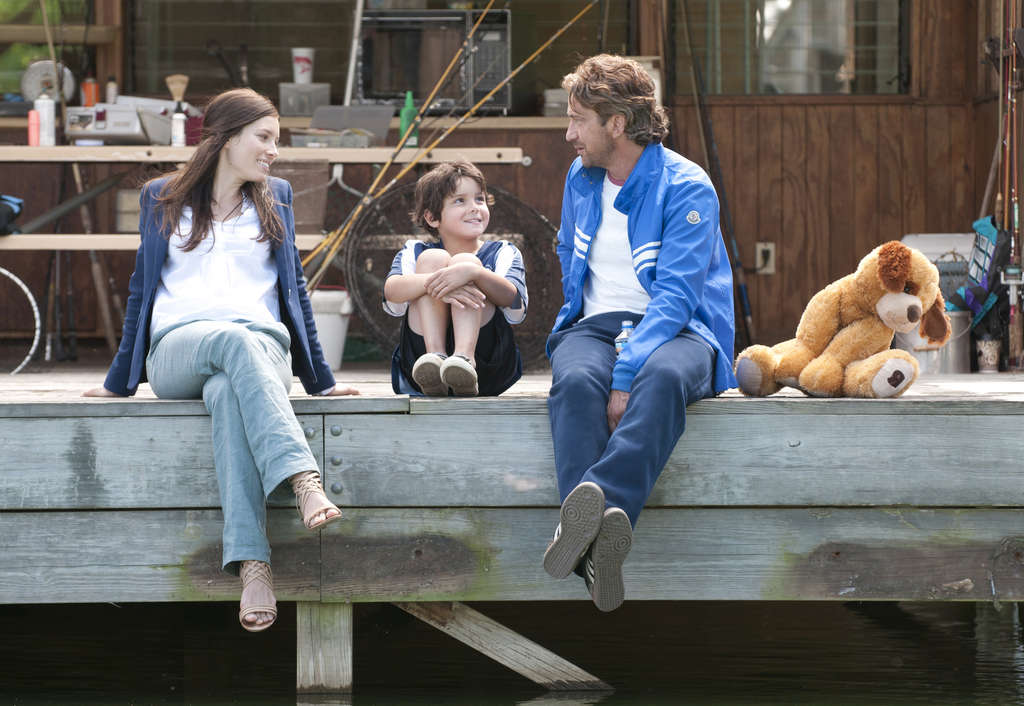 """Jessica Biel, Noah Lomax, and Gerard Butler (right) in a scene from """"Playing for Keeps."""" All exude charm in their portrayals, but the film doesn´t."""