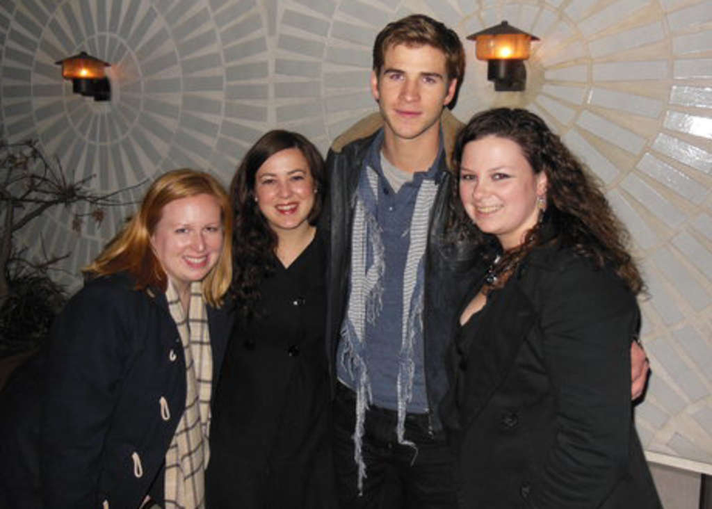 Actor Liam Hemsworth poses with fans (from left) Danielle Hanson, Jessica Remo and Kristin Golden at Continental Midtown late Saturday night.