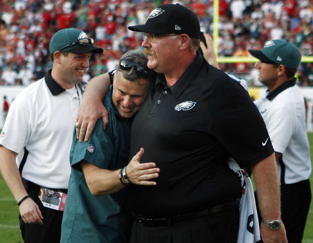 Eagles coach Andy Reid gets a hug from trainer Rick Burkholder after the win over the Bucs. RON CORTES / Staff
