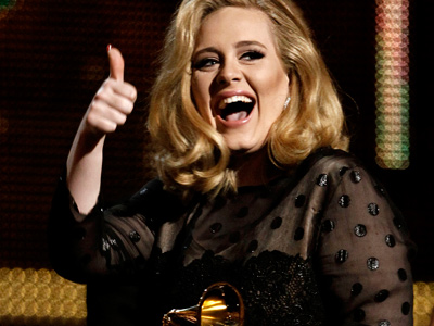 British pop singer Adele dominated the Grammy Awards on Sunday in a ceremony that was transformed into an emotion-packed memorial to Whitney Houston, who died a day earlier, at the age of 48.