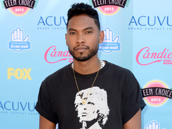 Miguel arrives at the Teen Choice Awards at the Gibson Amphitheater on Sunday, Aug. 11, 2013, in Los Angeles. (Photo by Jordan Strauss/Invision/AP)