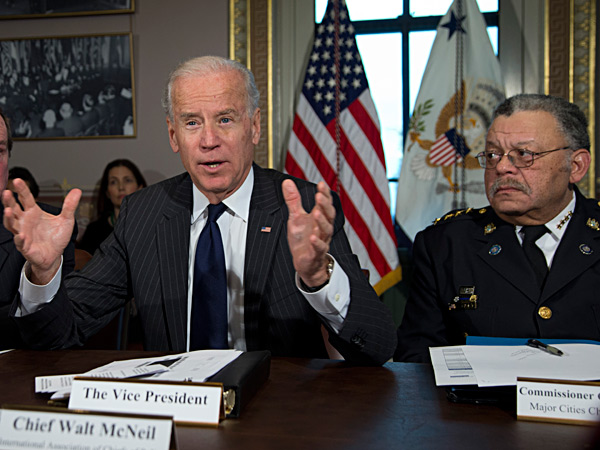 Vice President Biden, with Philadelphia Police Commissioner Charles Ramsey, right, speaks during a meeting in the White House complex on Dec. 20.  Biden is leading a task force that will look at ways of reducing gun violence. CAROLYN KASTER / Associated Press, file