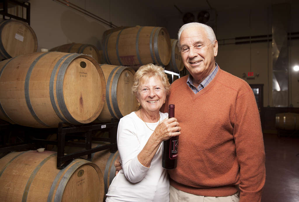 Nicholas and Athena Karabots with a bottle of their award-winning 2008 Meritage in the barrel room of their winery. There are 17 acres in vinifera vines - chardonnay, petit verdot, cabernet franc, cabernet sauvignon, and merlot - at Karamoor Farm.