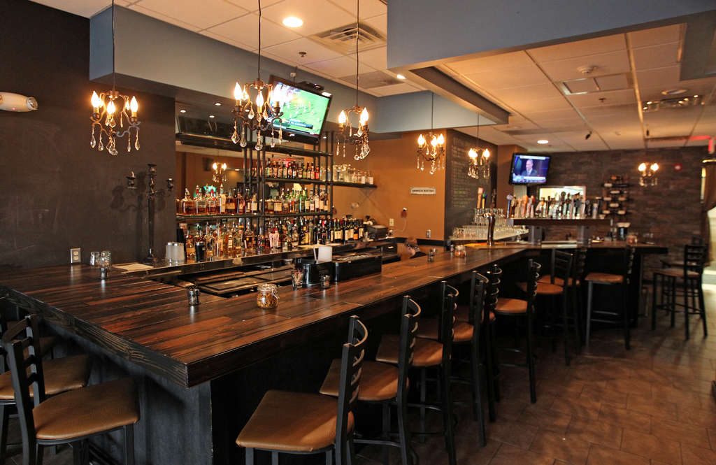 The downstairs bar at Southern Cross Kitchen in Conshohocken. Lunch and dinner are served, with entrees at night ranging from $14 to $28.