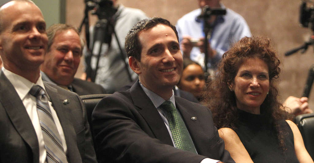DAVID MAIALETTI / STAFF PHOTOGRAPHER Eagles GM Howie Roseman , flanked by team president Don Smolenski and Christina Weiss Lurie, wears a hard-earned smile at Chip Kelly press conference.