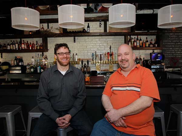 Owners Neil Campbell (left) and Andy Shahan at the bar at the new Goat Hollow in Mount Airy.  ALEJANDRO A. ALVAREZ / Staff Photographer