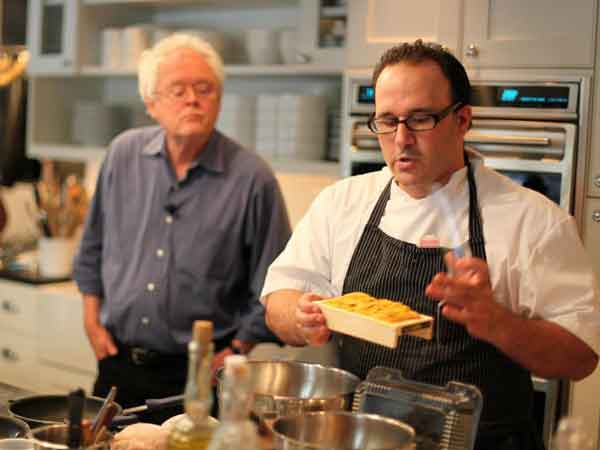 Matt Ridgway cooks at Cook, as food writer Rick Nichols looks on. (Photo via Cook)