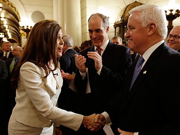 FILE: Gov. Corbett (right) and U.S. Sen. Bob Casey greeted Kathleen Kane before she took her oath of office as state attorney general last year. Kane and Corbett asked to be dismissed from a lawsuit filed by 28 same-sex couples. MATT ROURKE / Associated Press / File