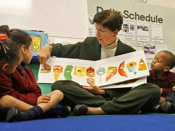 Camden County School Superintendent Peg Nicolosi with LEAP Academy University Charter pre-schoolers in 2009. Tax-exempt status was revoked. MICHAEL S. WIRTZ / Staff Photographer