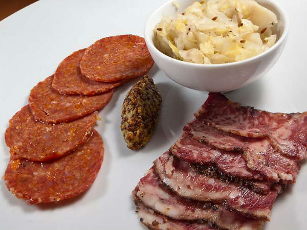 A tasting plate featured salami and pastrami with bread and - what else? - a dish of schmaltz.