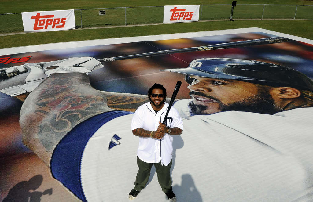 Nobody wanted the gum: Detroit´s Prince Fielder poses with his 90-by-60 foot baseball card.