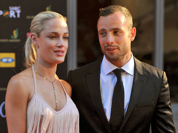 South African Olympic athlete Oscar Pistorius and Reeva Steenkamp at an awards ceremony, in Johannesburg, South Africa. Pistorius was taken into custody and expected to appear in court Thursday, Feb. 14, 2013, after Steenkamp was shot dead at his home in South Africa´s capital, Pretoria. (AP Photo/Lucky Nxumalo-Citypress)