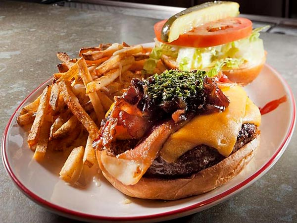 The 10-ounce burger with crispy bacon, cheddar, onion marmalade, and spicy chimichurri is a winner - though a bit pricey.