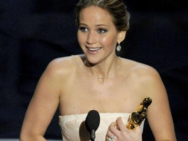 "Jennifer Lawrence accepts the award for best actress in a leading role for ""Silver Linings Playbook"" during the Oscars at the Dolby Theatre on Sunday Feb. 24, 2013, in Los Angeles.  (Photo by Chris Pizzello/Invision/AP)"