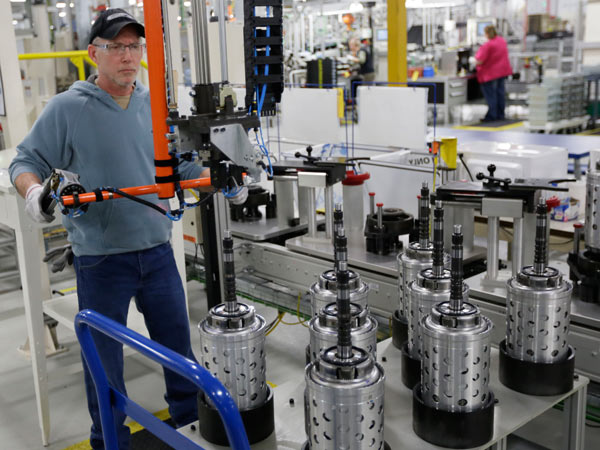 Dietz Werland works Thursday on the assembly line during a media tour before an investment and jobs announcement event at the Chrysler transmission plat in Kokomo, Ind. (AP Photo/AJ Mast)