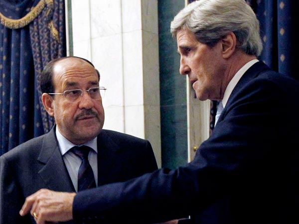 "Secretary of State John Kerry (right) with Iraq Prime Minister Nouri al-Maliki in Baghdad. ""I made it very clear . . . anything that supports [Syria´s] President Assad is problematic,"" Kerry said. JASON REED / Associated Press"