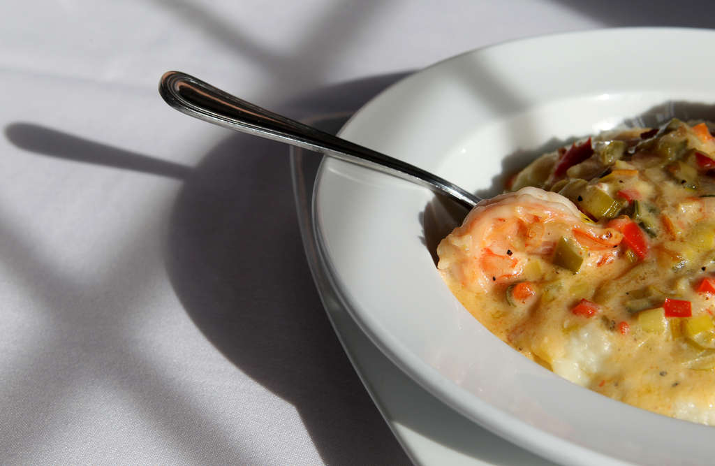 Creamy shrimp and grits, above, is among the more successful offerings at Southern Cross Kitchen in Conshohocken. (Charles Fox/Staff Photographer)