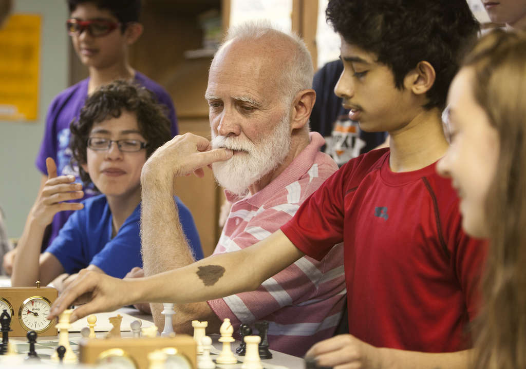 Steve Shutt spent four decades coaching Masterman´s chess team, retired, then came back. He is flankedby (from left) players Angel Hernandez-Camen, Srisa Changolkar, and Shira Moolten.