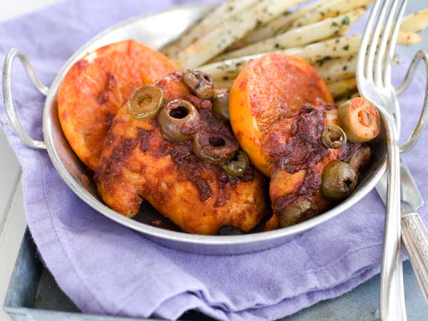 Honey-paprika chicken with roasted oranges.  (AP Photo/Matthew Mead)