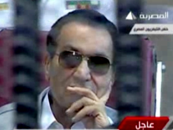 This image made from video broadcast on Egyptian state television shows former President Hosni Mubarak inside the defendant´s cage in a courtroom in Cairo, Egypt, Saturday, May 11, 2013. (AP Photo/Egyptian State Television via AP video)