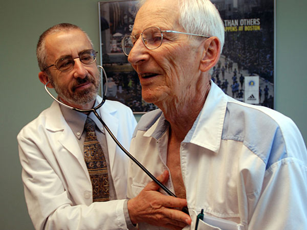 "Dr. Bruce Stowell examines patient Robert Busch. When buying health insurance, where you live matters. A 40-year-old in Philadelphia, for instance, will spend $300 a month to buy a mid-level insurance plan in the new ""Obamacare"" marketplace - 77 percent more than a 40-year-old in Pittsburgh, where the same type of coverage will cost a more modest $169 a month. (AP Photo/Jeff Barnard)"