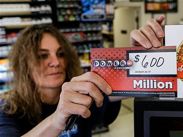 Sheila Sutton updates the Powerball prize money sign at the Super C convenience store in Lincoln, Neb., Friday, May 17, 2013. The final jackpot, won in Florida, was actually $590.5 million,  million, still making it the largest prize in the game´s history and the second largest lottery prize in U.S. history. Sutton sold a million dollar Powerball ticket on Tuesday. (AP Photo/Nati Harnik)