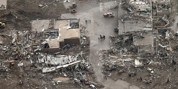 This aerial photo shows damage to buildings hit by a massive tornado in Moore, Okla., on Monday. (AP Photo/Steve Gooch)