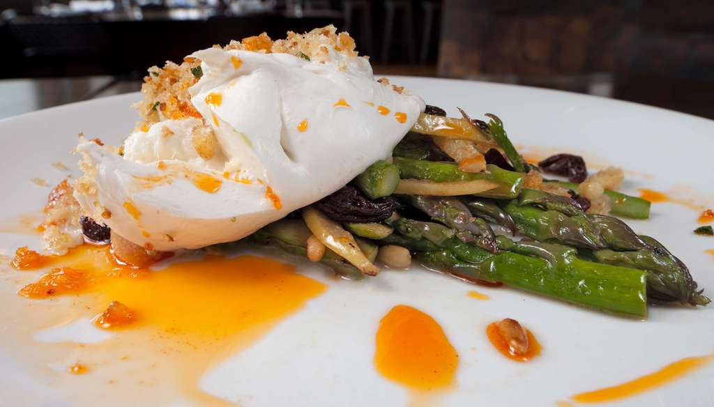 Among appetizers at Bufad is the creamy burrata mozzarella with asparagus, preserved lemon, raisins, chili oil - topped with Grandma Clara´s crispy bread crumbs.
