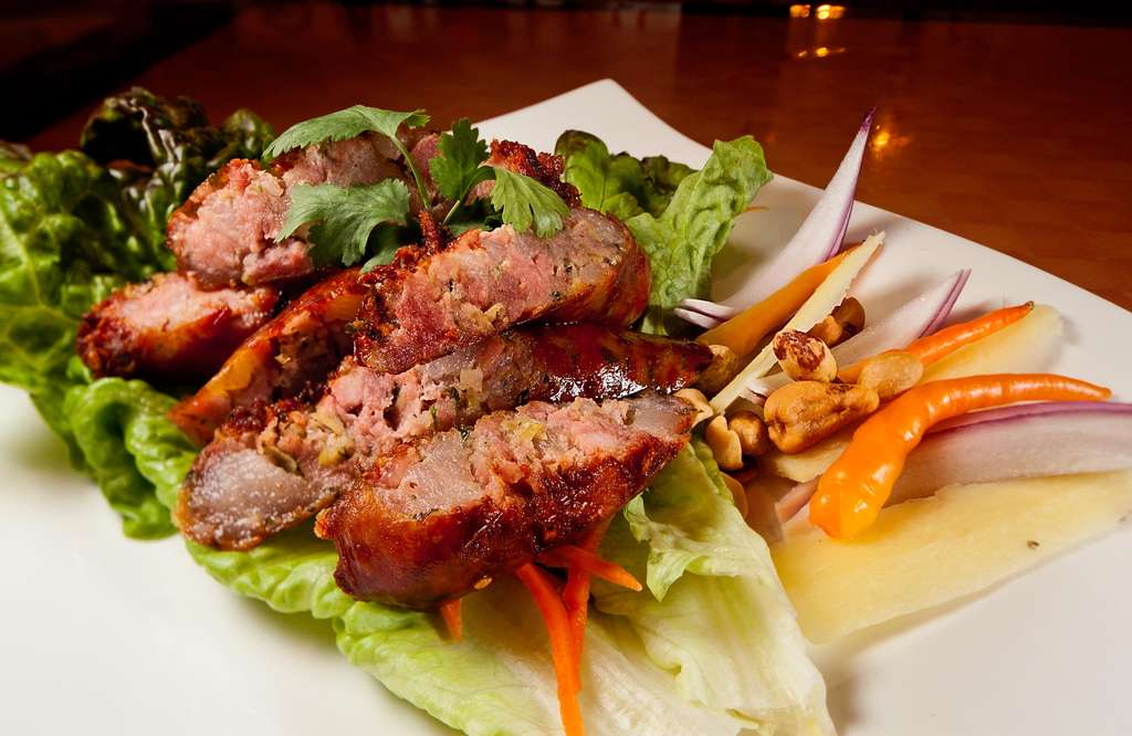 House-made Thai sausage bursting with lemongrass, galangal, and fresh chile. For a taste sensation, eat it with fresh ginger and roasted peanuts.