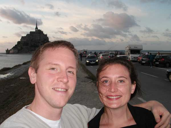 Ben and Elena Thomas of Restaurant Cerise in Bryn Mawr in front of Mont St. Michel on the northwest coast of France.