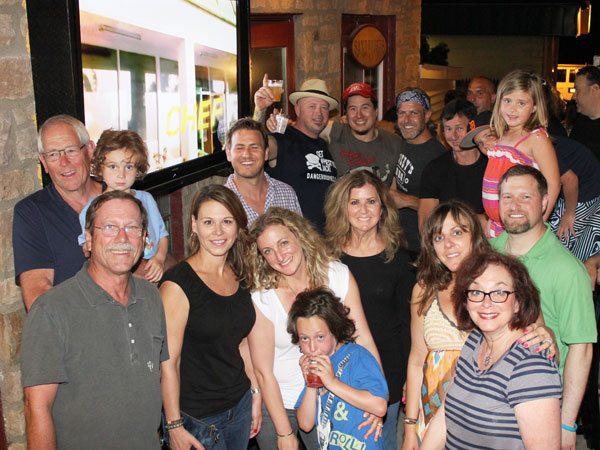 "Friends and family gather for a ""Next Food Network Star"" viewing party June 23, 2013, at Maple Glen Tavern. In rear are contestants Rodney Henry (in hat), bluesman Sean K. Preston, and Ambler´s Chad Rosenthal. Reid Rosenthal, Chad´s brother and a ""Bachelorette"" alumnus, is in front of them, in a blue shirt."