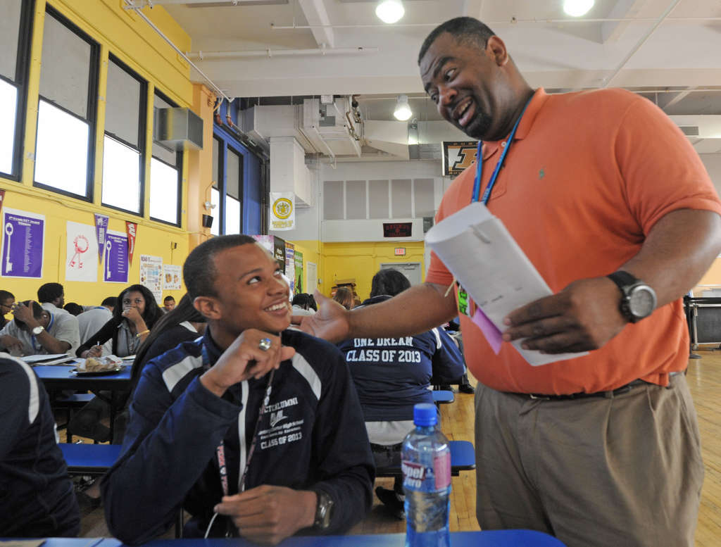 Dean of students Tony Anderson talks with Kevin Beaford, 18, a Gates Millennium Scholar, at Mastery Thomas Charter School.