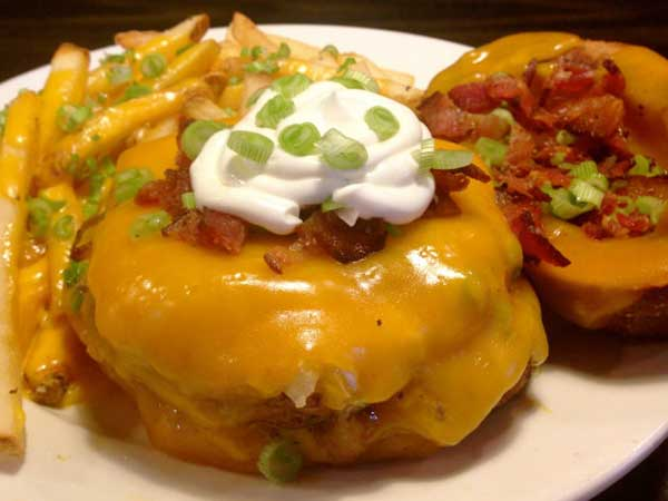 "PYT´s latest coronary-inducer: A burger served on a ""bun"" of two potato skins loaded with cheddar, bacon, chives and sour cream."