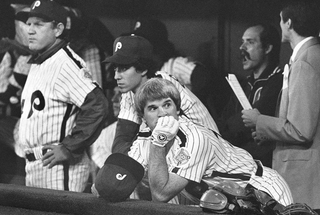 ASSOCIATED PRESS FILE PHOTO Pete Rose, benched for Game 3 of the 1983 World Series, is perched on the top step of the dugout.