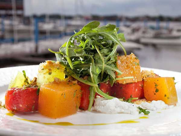 """All kinds of melons"" is a medley of fruit that´s been compressed with ginger beer, grilled or pickled, and tossed in watermelon vinaigrette, tarragon and candied hazelnuts."