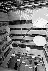 "Created by Alexander Calder not long before his death, ""White Cascade"" is thought to be the world´s largest mobile. It descends from skylight through 100 feet of the Federal Reserve Bank´s 130-foot-high East Court. (fpaa.org)"