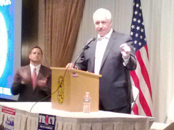 Joseph DeFelice, left, listens as Gov. Tom Corbett speaks during a meet-and-greet with city Republicans on Tuesday in Northeast Philadelphia. (Photo by Darin Bartholomew)