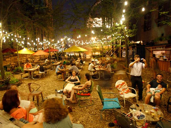 The Pennsylvania Horticultural Society´s pop-up beer garden, with amphitheater seating built from shipping pallets, offered a spot to relax on South Broad Street in Center City.  (Yong Kim/Staff Photographer)