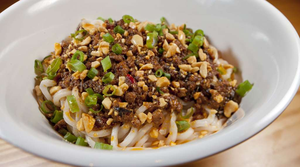 Dan Dan noodles with ground pork, zha cai, chile oil, and scallion, a highlight at Yuboka noodle bar.