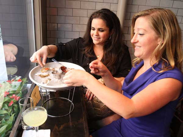 Adeline Abdesaken (left) and Amanda Congar enjoy oysters at Pennsylvania 6 at 114 S. 12th St.