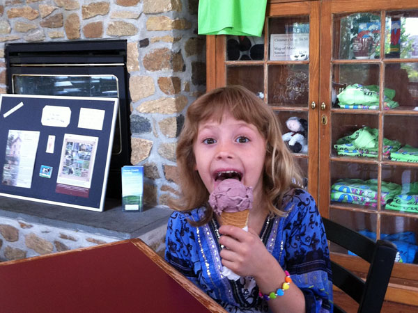 Anna Eaglehouse, 6, of Chester Springs, enjoys a cone of Bessie&acute;s<br />Black Raspberry ice cream, homemade from the dairy cows&acute; milk at Milky Way Farm&acute;s&acute; Chester Springs Creamery.