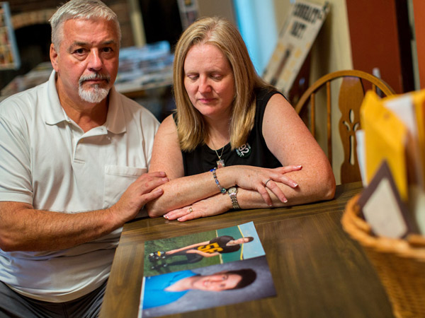 John and Kathleen Kocher look over pictures of their son, Matthew, who drowned in Lake Michigan recently in a rip tide. Internet trolls hijacked the Facebook page dedicate to Matthew´s memorial posting rude comments about him and his death. (Zbigniew Bzdak/Chicago Tribune/MCT)