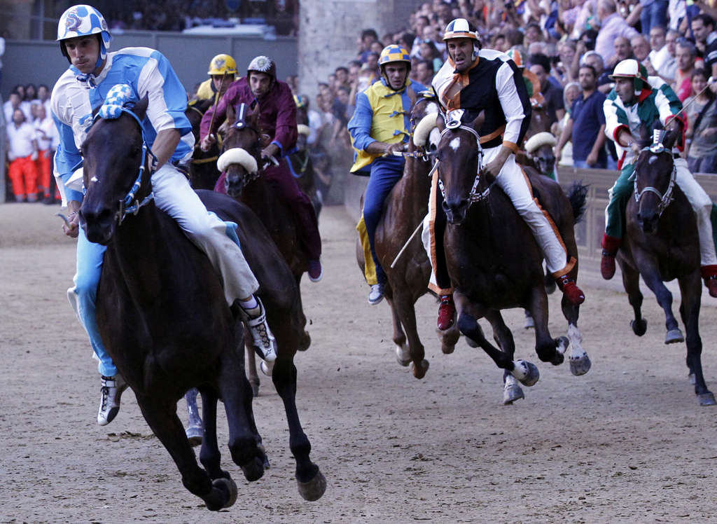 ASSOCIATED PRESS Horses gallop in last Friday´s Palio di Siena, an Italian race pols want to replicate in Atlantic City.