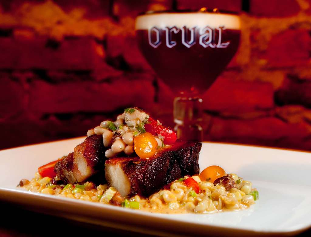 Crispy pork belly with maque choux, black-eyed peas, and tomato salad. Though Southern-influenced, the menu is not limited to regional cuisine. Vegetarians will find plenty to choose from, as well.