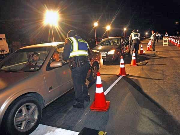 Drivers line up at a DUI checkpoint. (AP file photo)