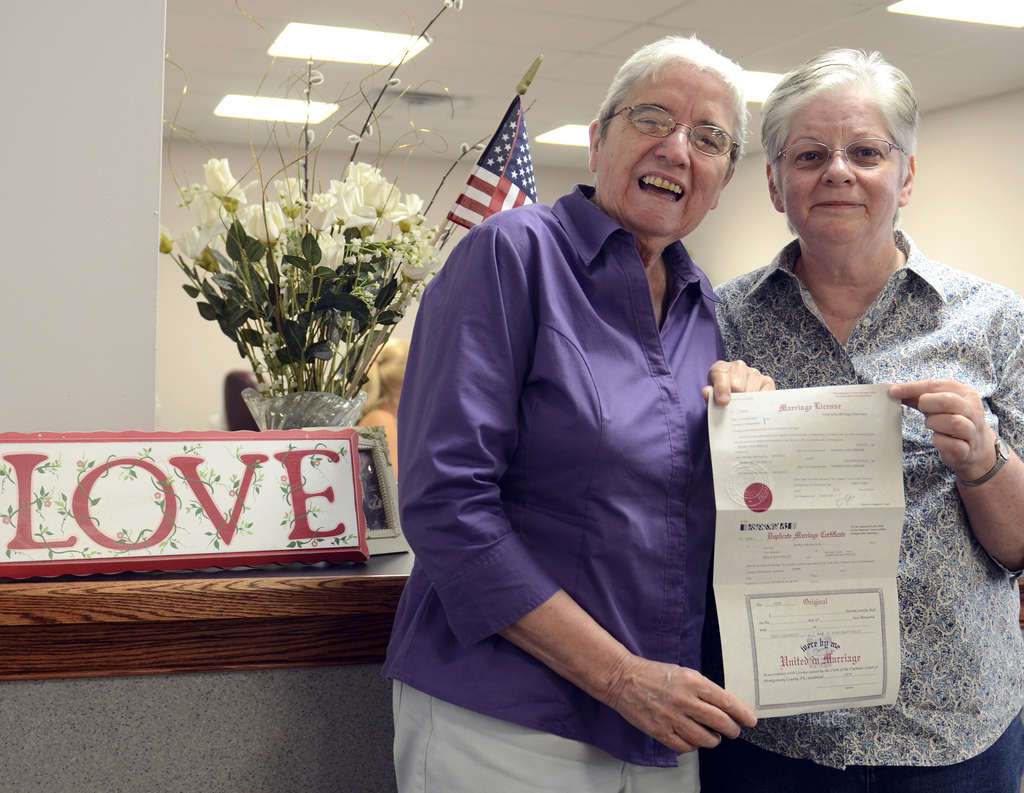 Peg (right) and Delma Welch of York, Pa., with their marriage license, which they obtained in Norristown, where the Montgomery County register of wills has defied the governor.