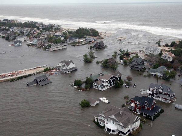 An aerial view of  the damage to the shoreline and the houses in Mantoloking, N.J., following Superstorm Sandy. (AP Photo/U.S. Air Force, Master Sgt. Mark C. Olsen, File)