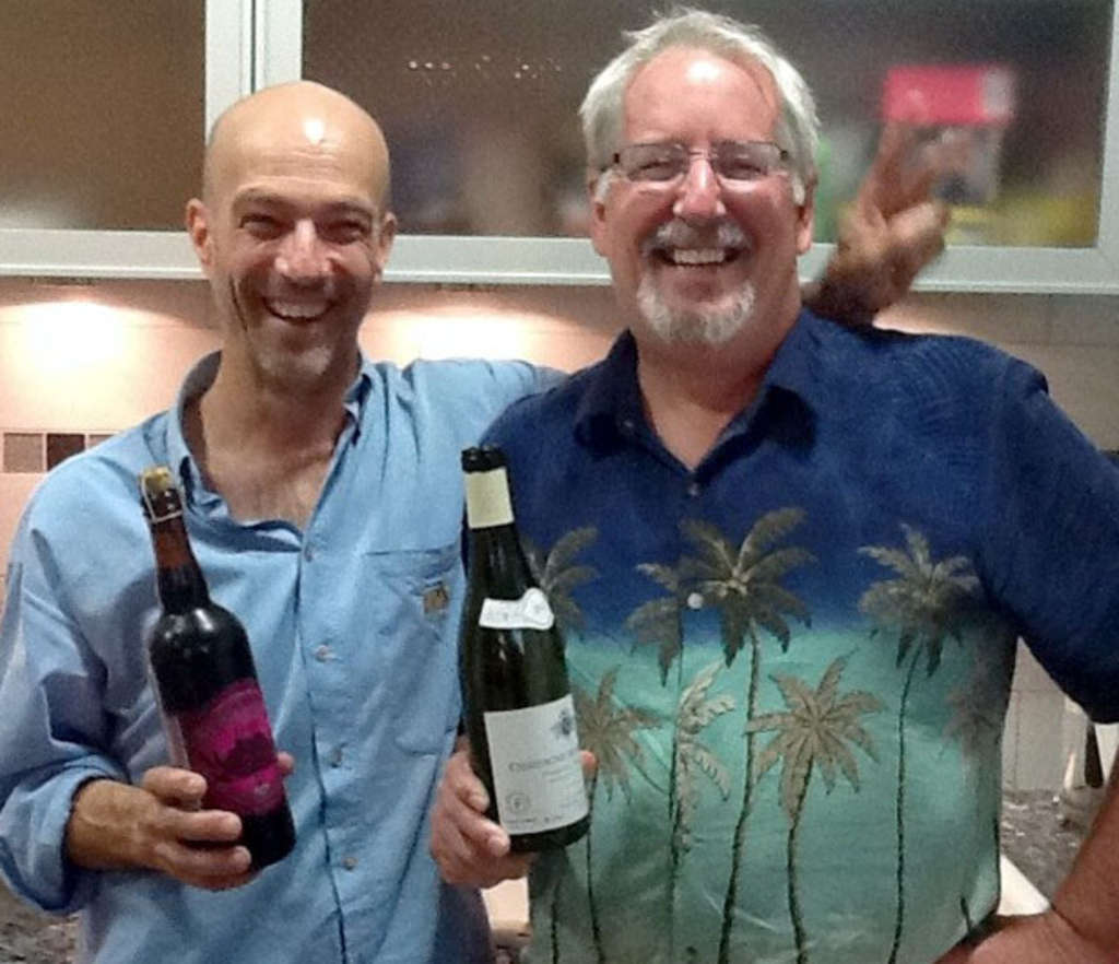 Wine expert Pascal Wagner (left) with a bottle of France´s Montrachet; Joe has a Sly Fox Black Raspberry Reserve, from Pottstown.