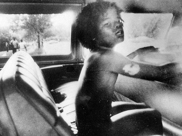 Birdie Africa sits in a police van after escaping the fire at the MOVE compound on May 13, 1985. MICHAEL MALLY / File photo