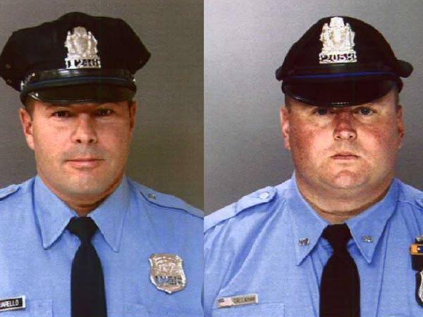 Philadelphia police Officers John Pasquarello, left, and John Callahan, right, are credited with saving the life of a 9-year-old boy two weeks ago.